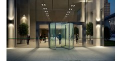 ASSA ABLOY RD300 all-glass revolving door at night