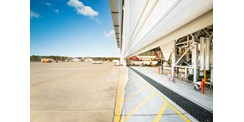Multiple leaf aviation hangar door system used by Qantas