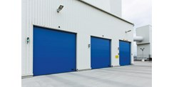 ASSA ABLOY universal overhead sectional door at Cementa, Malmo Harbour, Sweden